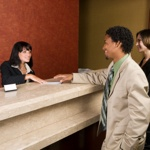 image of hotel clerk helping customers